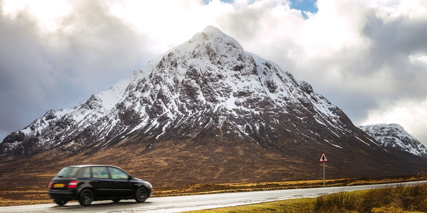 Travel Tips sky mountain outdoor grass highland mountainous landforms snow landform geographical feature mountain range wilderness car Nature cloud hill fell ridge mountain pass alps landscape loch plateau road trip vehicle summit clouds day