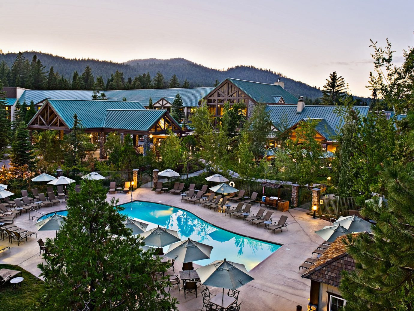 Country Family Travel Grounds Lodge National Parks Patio Pool Rustic Trip Ideas tree sky outdoor leisure Resort Town vacation estate house neighbourhood residential area Village home amusement park park several