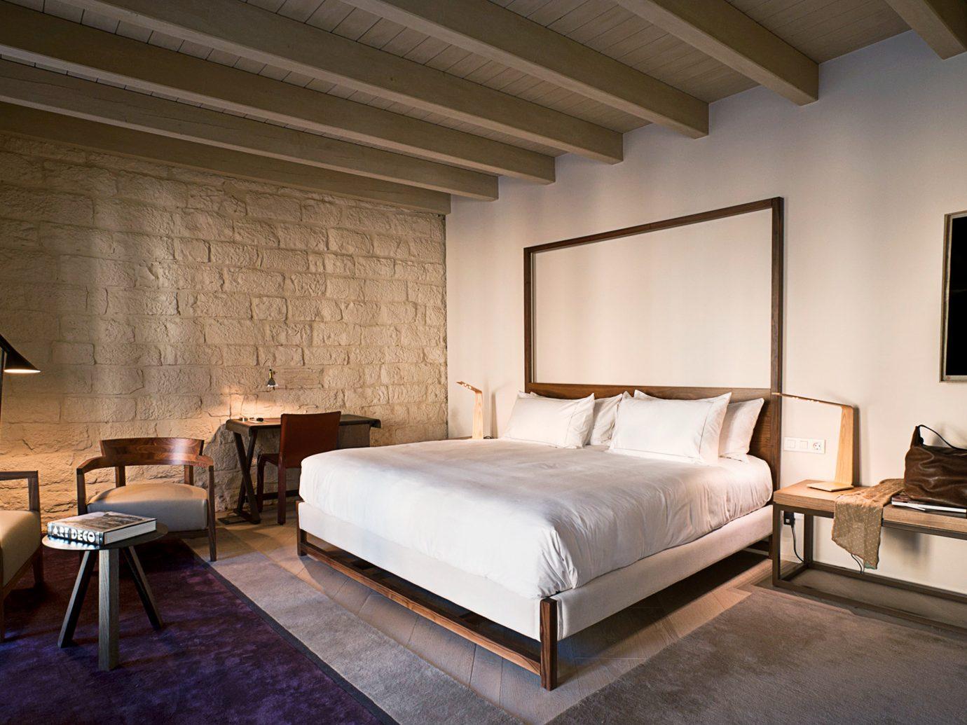 Barcelona Boutique Hotels Hotels Spain indoor floor bed wall room Bedroom property ceiling interior design estate Suite Design furniture living room hotel cottage real estate loft Villa