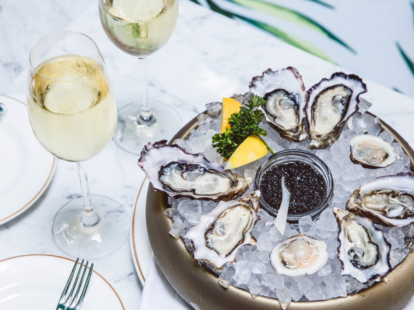 Food + Drink Travel Tips plate table oyster food Seafood clams oysters mussels and scallops animal source foods brunch tableware clam dish platter recipe several meal