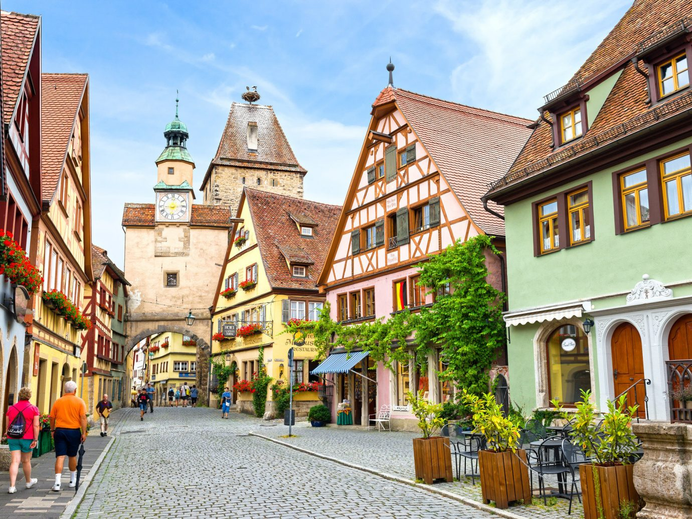 Travel Tech Travel Tips building outdoor Town road neighbourhood street City human settlement scene vacation tourism residential area way infrastructure cityscape Downtown facade travel Village stone