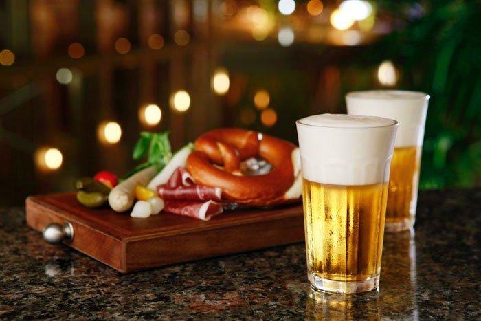Food + Drink table cup indoor alcoholic beverage Drink meal distilled beverage sense restaurant beer Bar