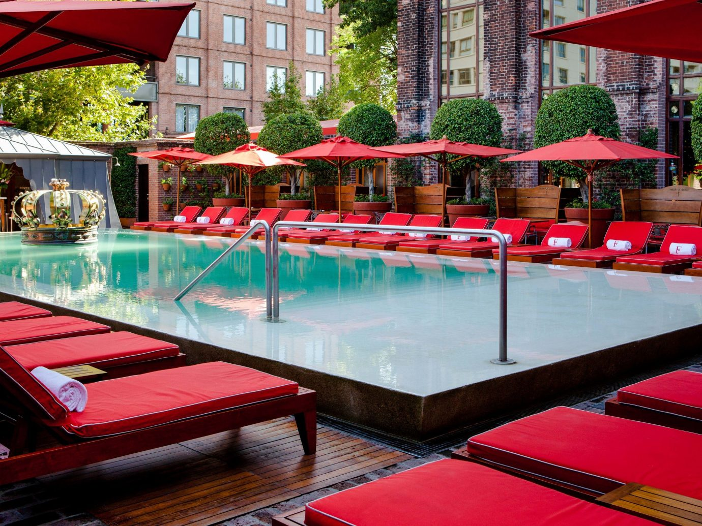 Boutique Hotels Luxury Travel building outdoor red swimming pool leisure table Resort recreation room leisure centre amenity hotel colorful