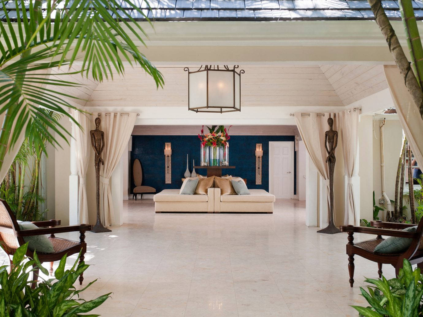 Hotels Luxury Travel plant indoor floor Living window property room estate interior design furniture home living room real estate house backyard Resort Courtyard Patio Villa outdoor structure Lobby flooring hacienda area decorated dining table