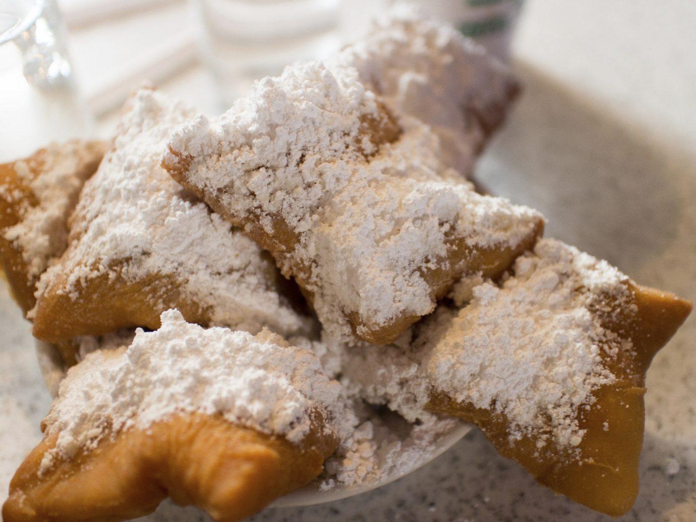 Trip Ideas Weekend Getaways food dish doughnut piece dessert half powdered sugar cuisine baked goods eaten baking beignet snack food sugar flavor close