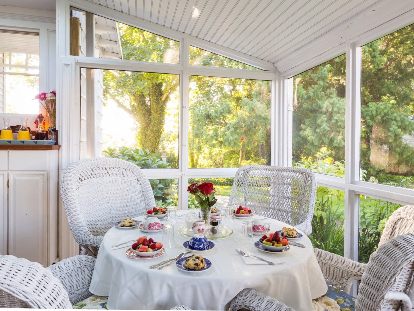 Hotels window indoor home property porch table dining room house outdoor structure real estate interior design furniture estate backyard cottage tablecloth Patio living room linens decorated
