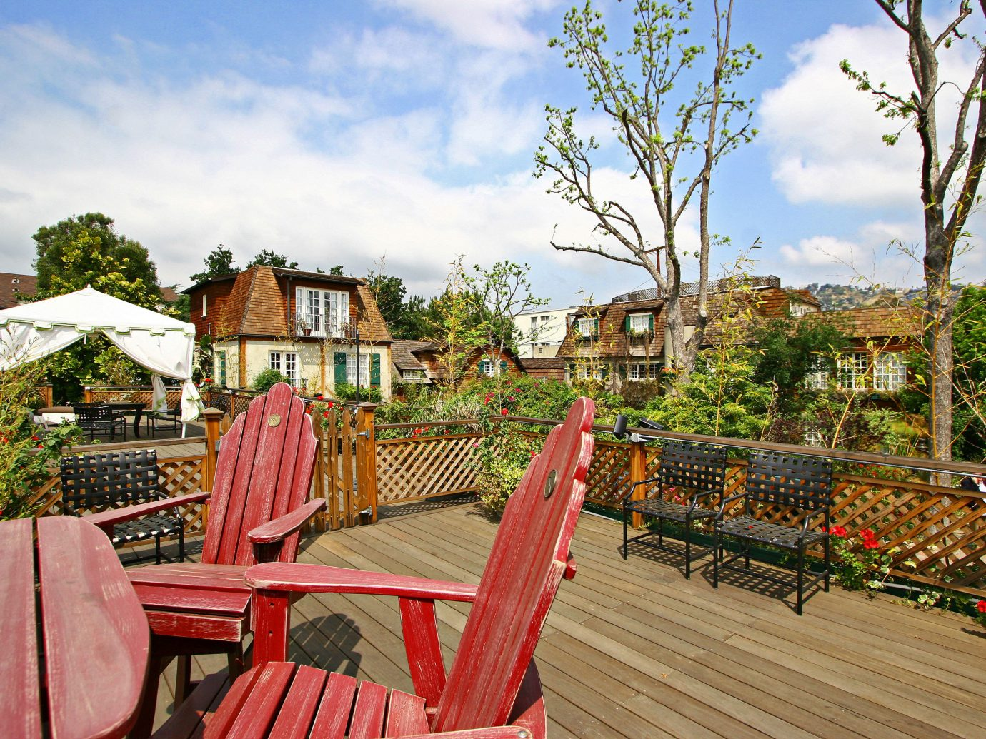 Architecture Buildings Exterior Garden Grounds Hotels sky outdoor tree ground chair human settlement vacation house estate Resort tourism home flower backyard porch set furniture Deck several
