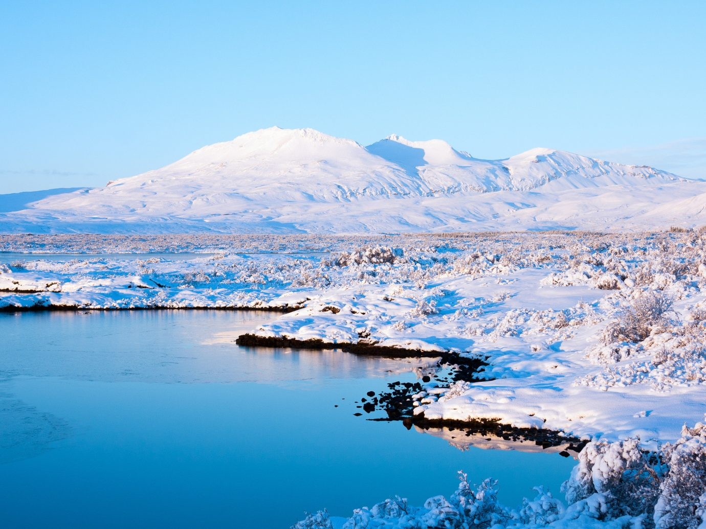 Iceland Trip Ideas water sky outdoor mountain mountainous landforms snow Nature Lake landform Boat geographical feature Winter weather mountain range season loch reflection arctic ice landscape arctic ocean Sea crater lake alps glacial landform surrounded shore