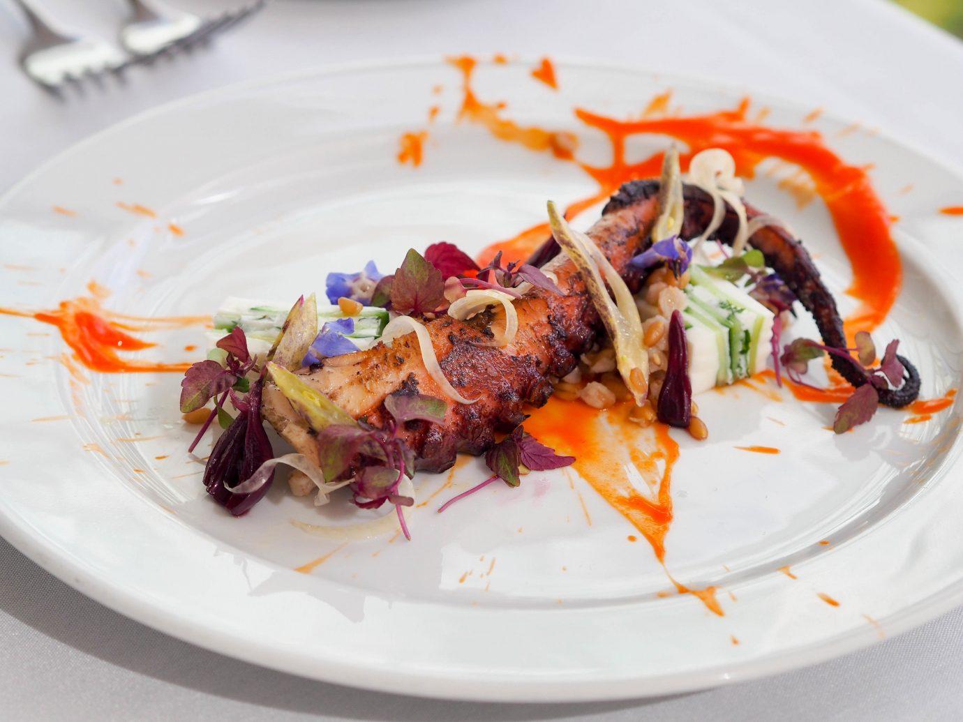 Road Trips Trip Ideas plate food table dish white indoor cuisine piece Seafood animal source foods mediterranean food recipe appetizer greek food grilled food meat eaten meal arranged piece de resistance