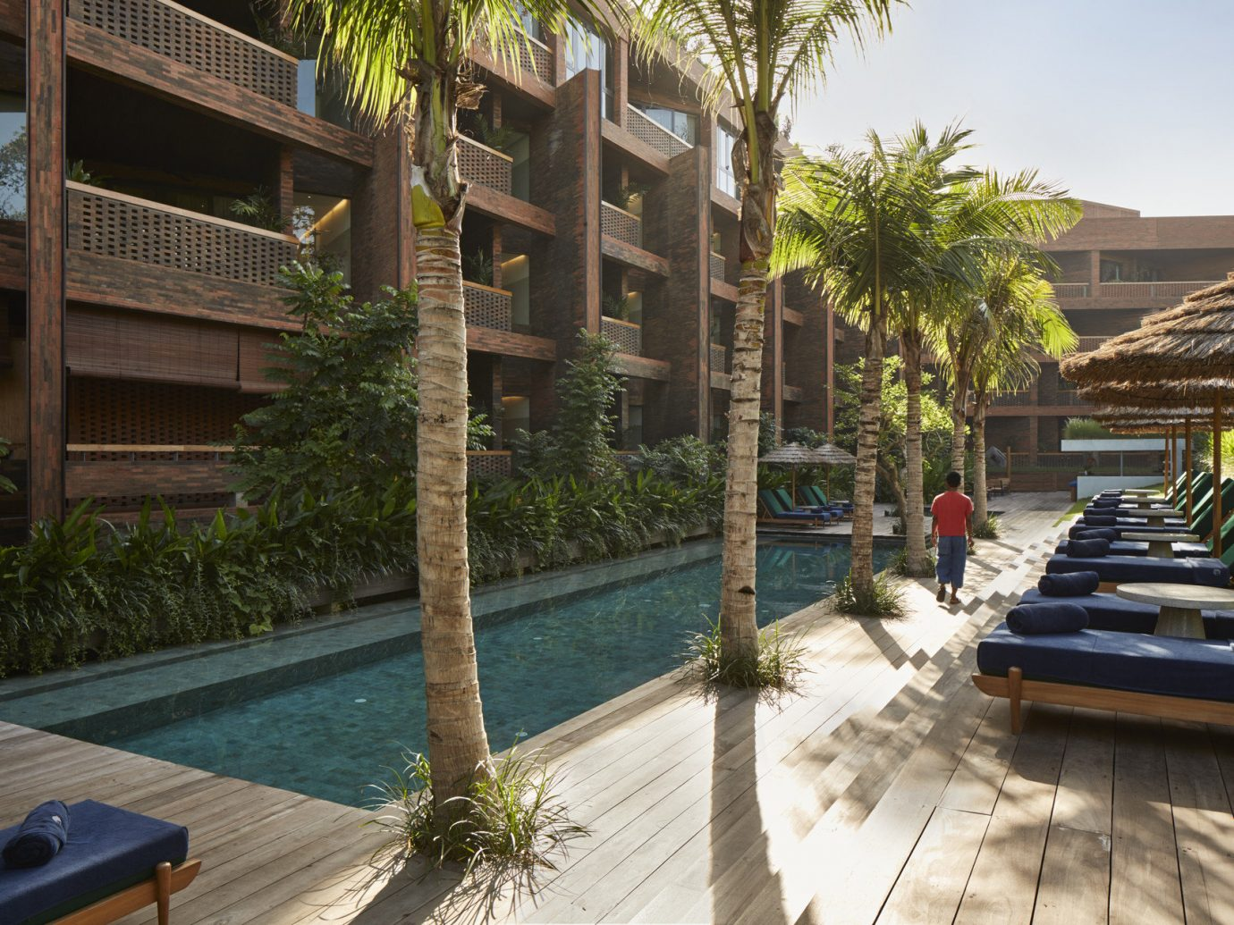 Health + Wellness Hotels outdoor tree property swimming pool Resort condominium estate vacation Villa real estate Courtyard backyard home mansion outdoor structure stone