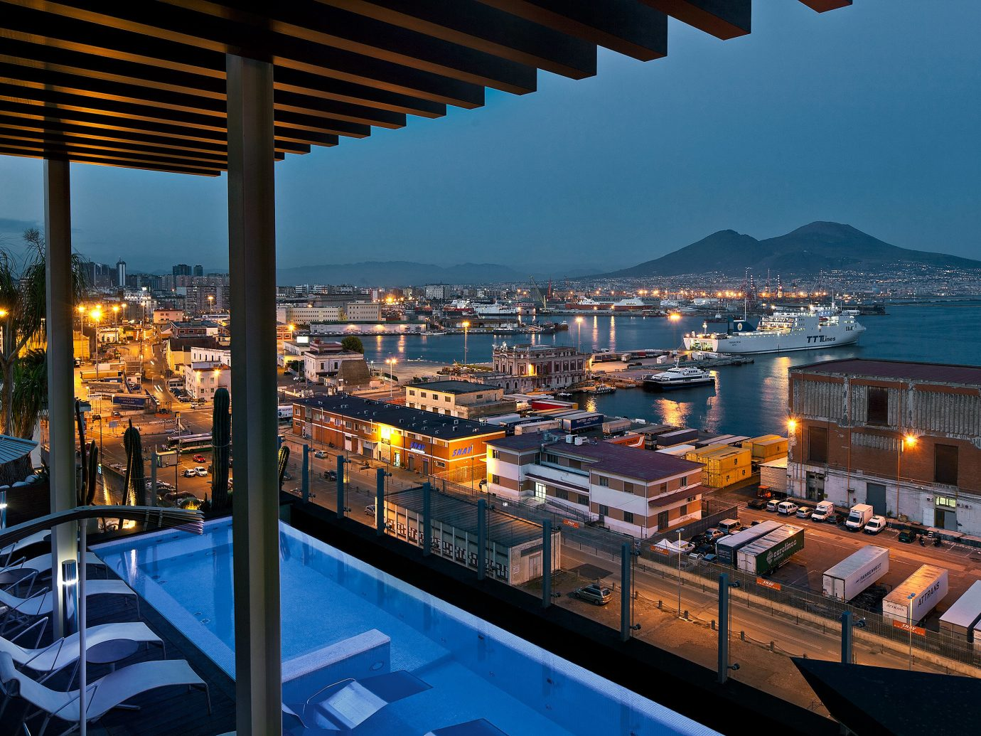 Adult-only Boutique Drink Hotels Lounge Modern Patio Pool Rooftop Waterfront sky outdoor marina dock evening Resort vehicle reflection cityscape overlooking