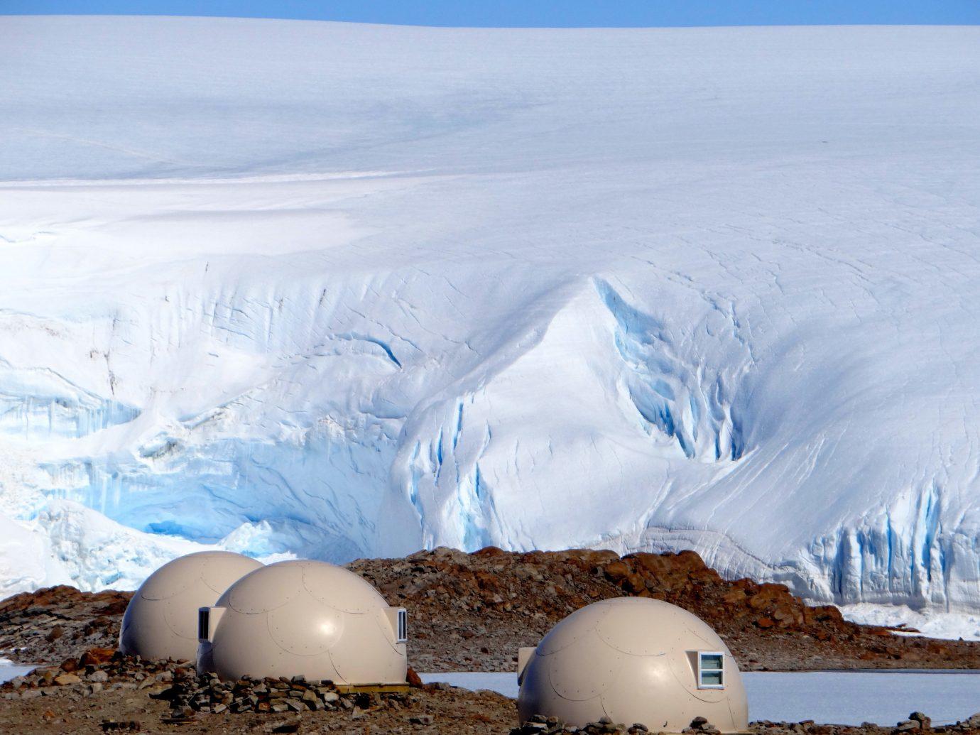 Luxury Travel Trip Ideas arctic ice cap sky ice polar ice cap tundra ecoregion glacial landform nunatak mountain