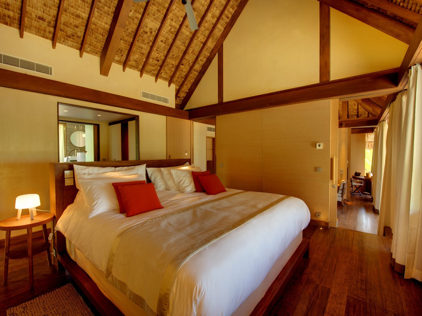 All-Inclusive Resorts ambient lighting beach house bed Bedroom Hotels hut Luxury Luxury Travel remote Romantic Hotels Rustic serene indoor floor wall room hotel property building ceiling cottage estate Suite real estate Villa