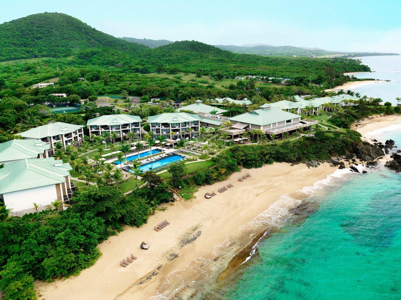 sky outdoor water mountain Beach Nature Coast Resort Sea vacation caribbean bay Water park estate tropics cape Village cove shore swimming sandy