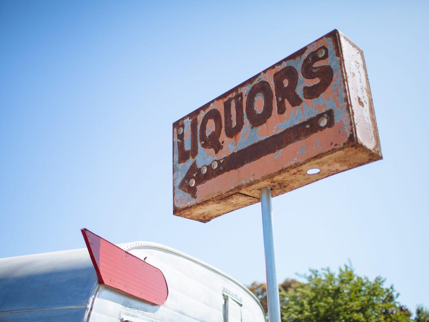 Food + Drink Girls Getaways Trip Ideas Weekend Getaways sky outdoor sign blue text advertising street sign signage traffic sign billboard