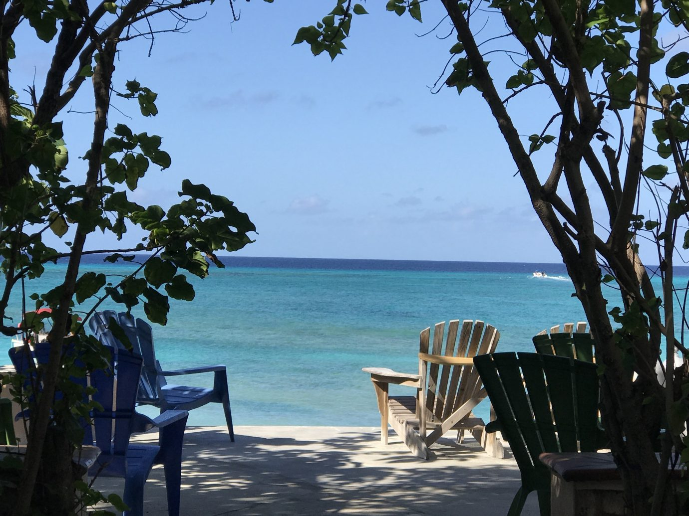 Hotels outdoor tree sky water Beach chair body of water vacation Sea Ocean Resort estate Coast bay caribbean arecales tropics overlooking shade shore day dining table