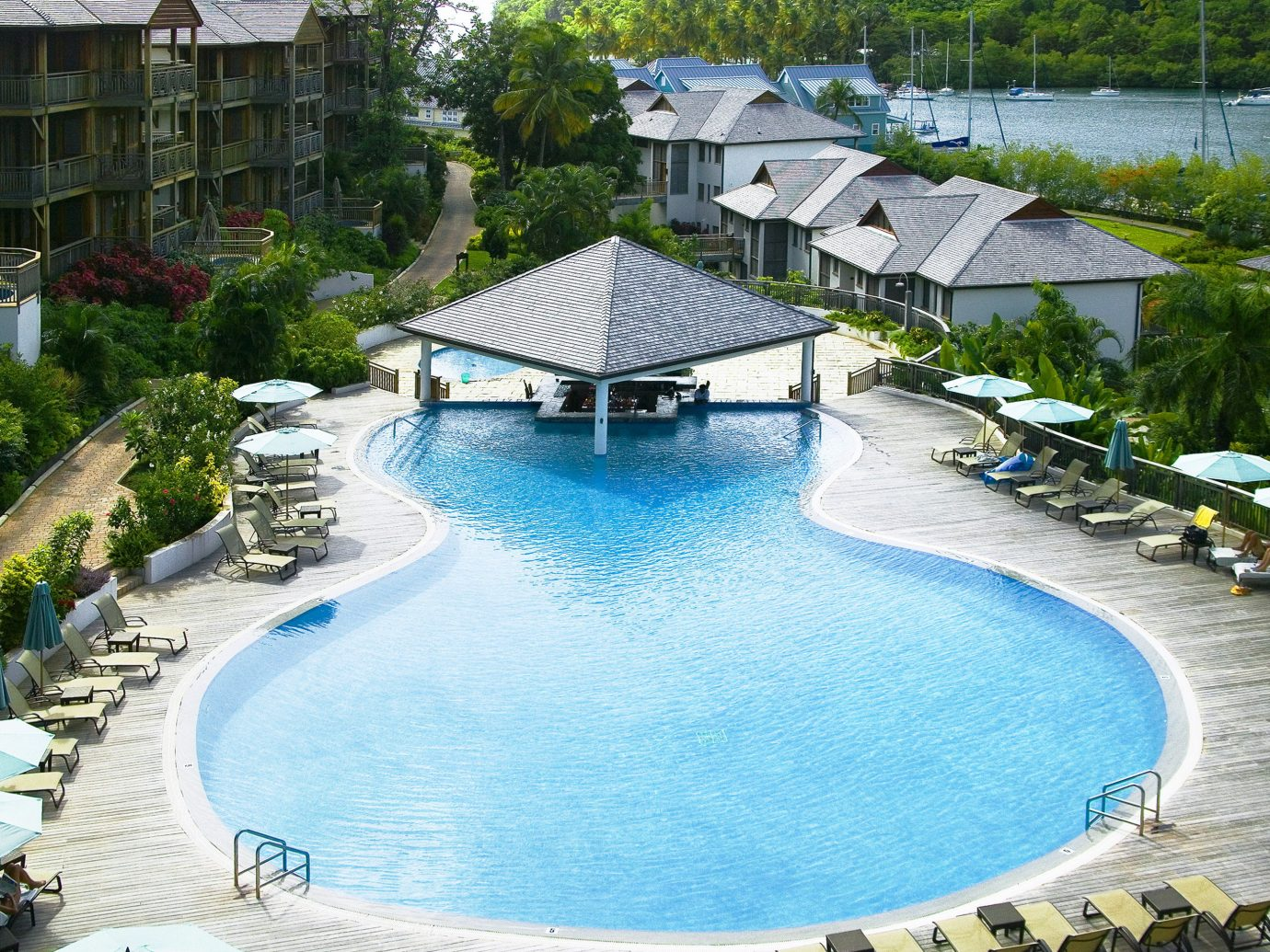 Hotels Luxury Travel water swimming pool outdoor Resort Pool property estate backyard condominium resort town swimming Villa surrounded