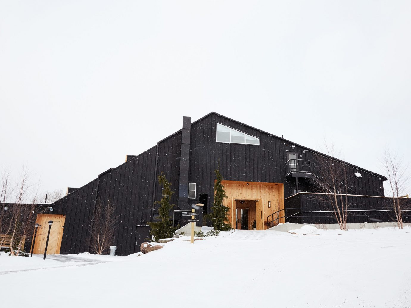 alpine skiing East Coast USA Secret Getaways Trip Ideas snow outdoor sky building Winter house property home Architecture residential area wood barn facade roof shed freezing farm building Town