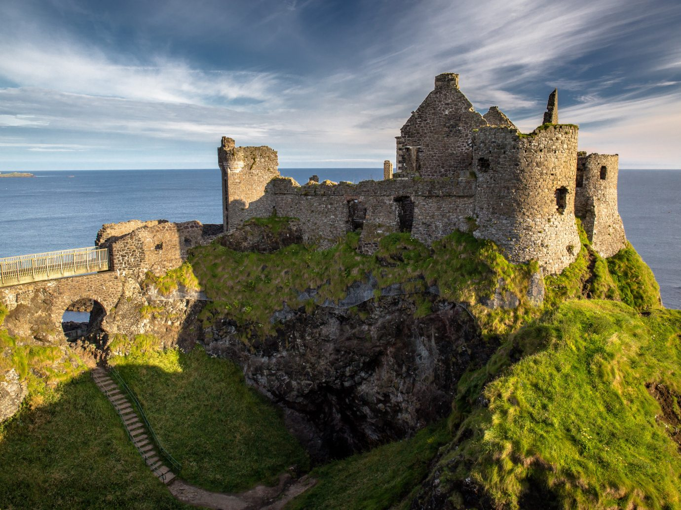Offbeat sky building outdoor castle landmark Coast Ruins fortification cliff Sea rock tower château landscape terrain ancient history monastery