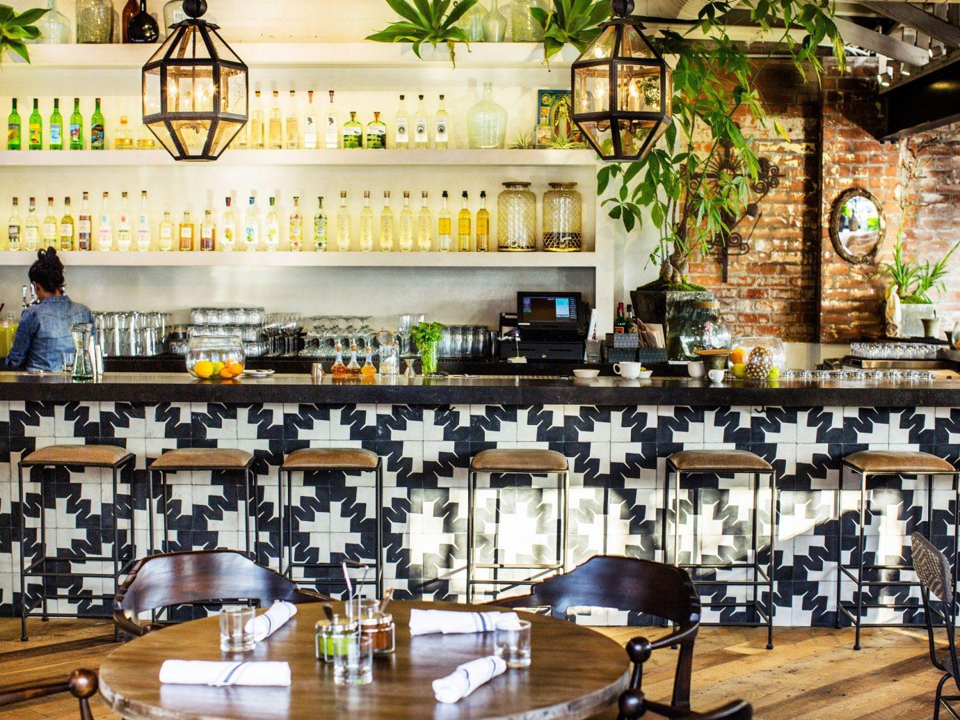 Jetsetter Guides indoor room restaurant Bar meal estate furniture