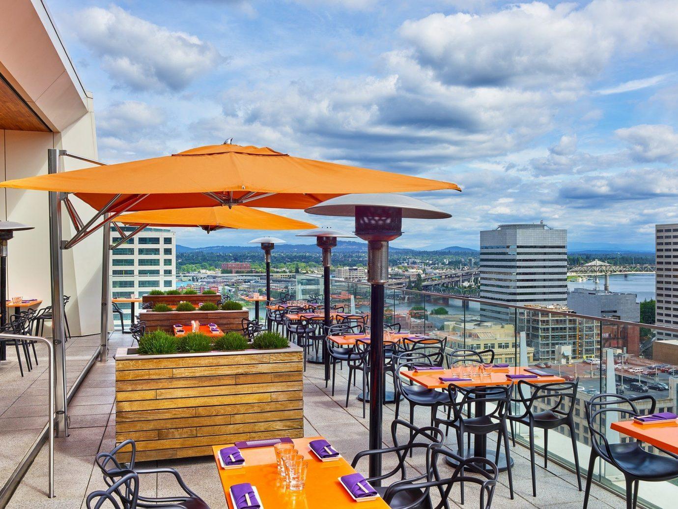 Food + Drink sky outdoor chair leisure property Resort restaurant vacation real estate plaza condominium orange furniture