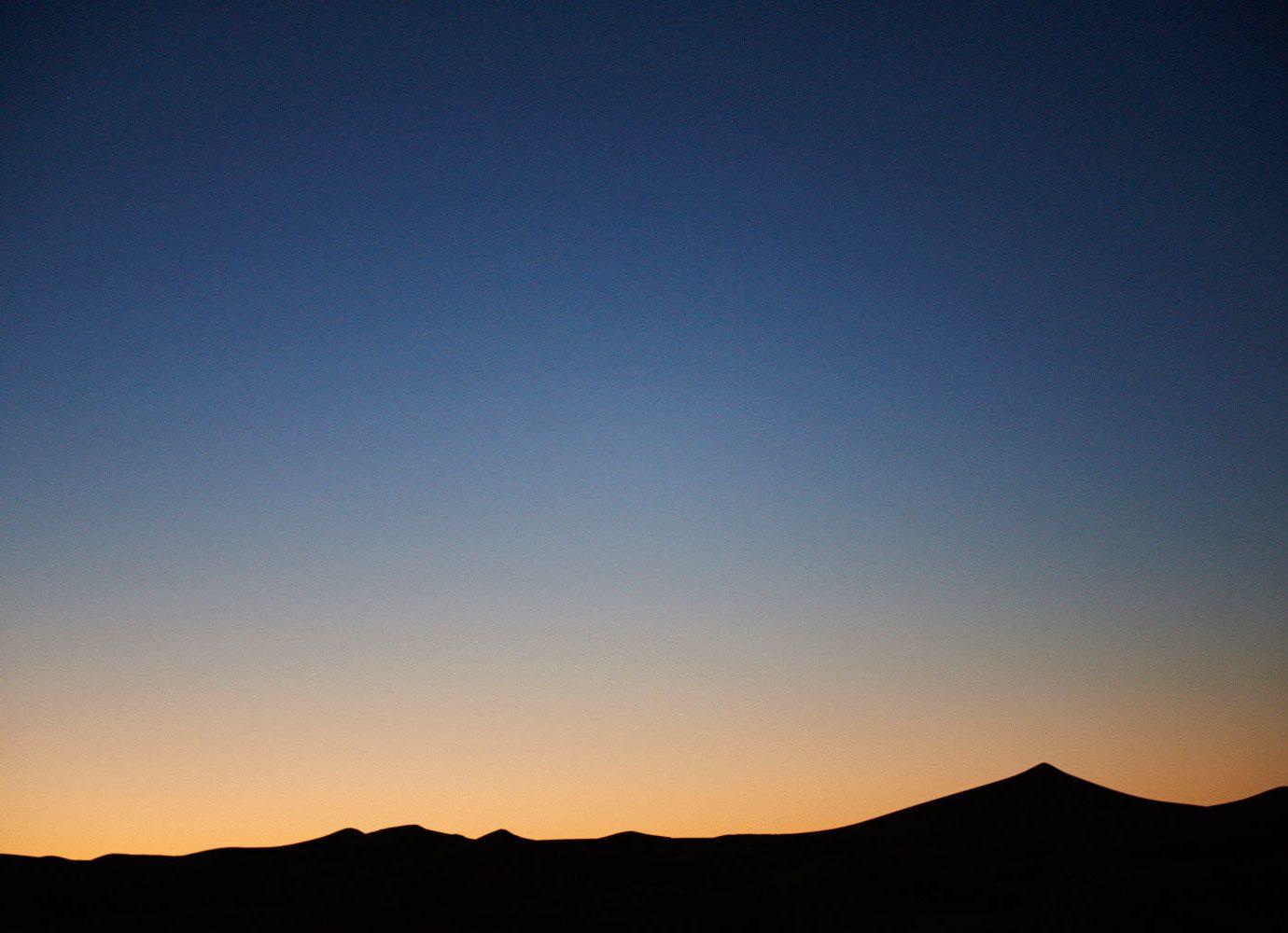 dawn Desert dusk golden hour isolation Night Sky orange sky remote sand sand dunes Sunset Trip Ideas sky outdoor horizon mountain atmosphere sunrise afterglow cloud morning evening sunlight clouds distance day highland
