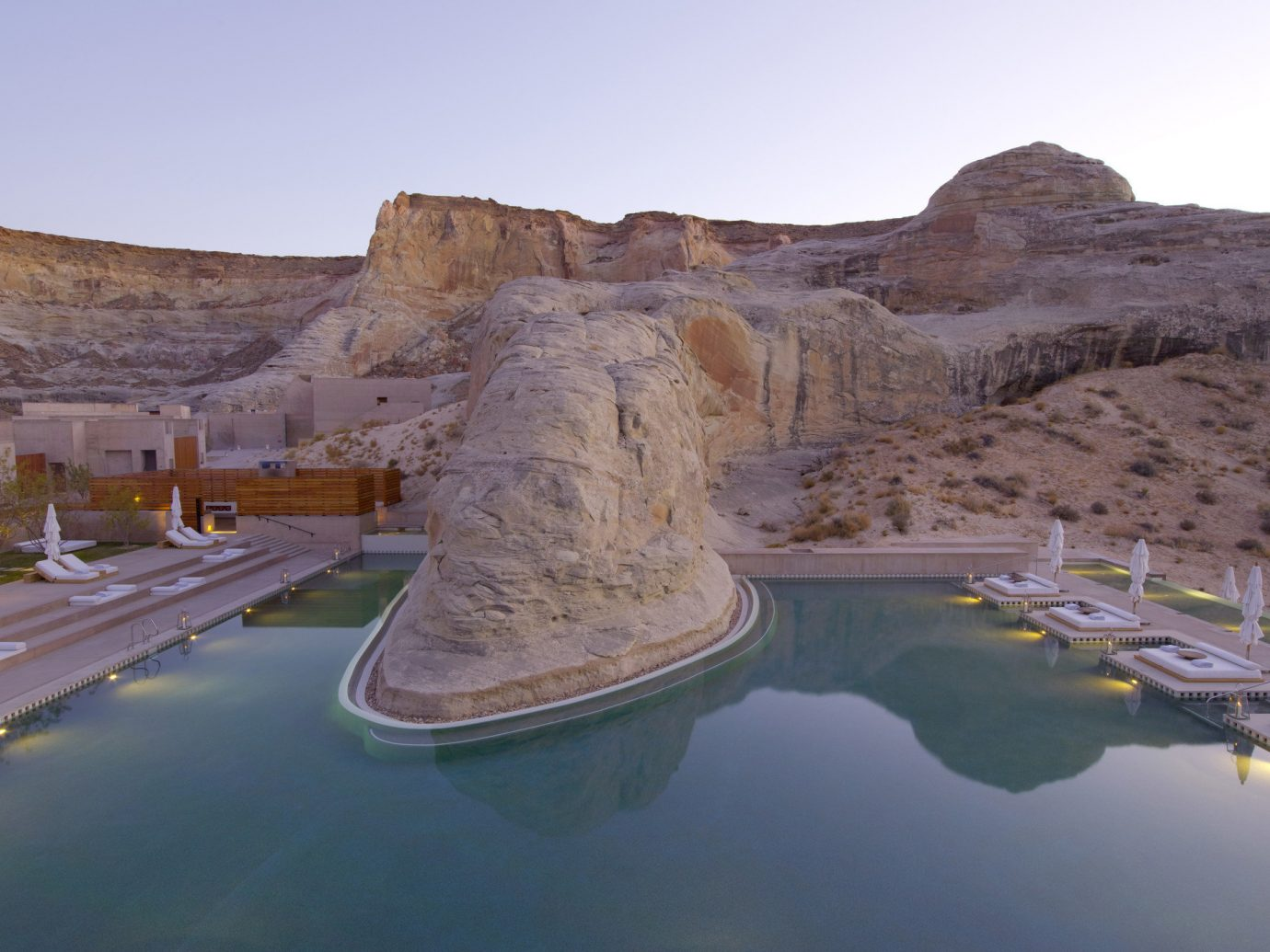 ambient lighting Hotels lounge chairs Luxury Pool Rocks sky outdoor mountain valley badlands Lake wadi landscape reflection reservoir terrain cliff