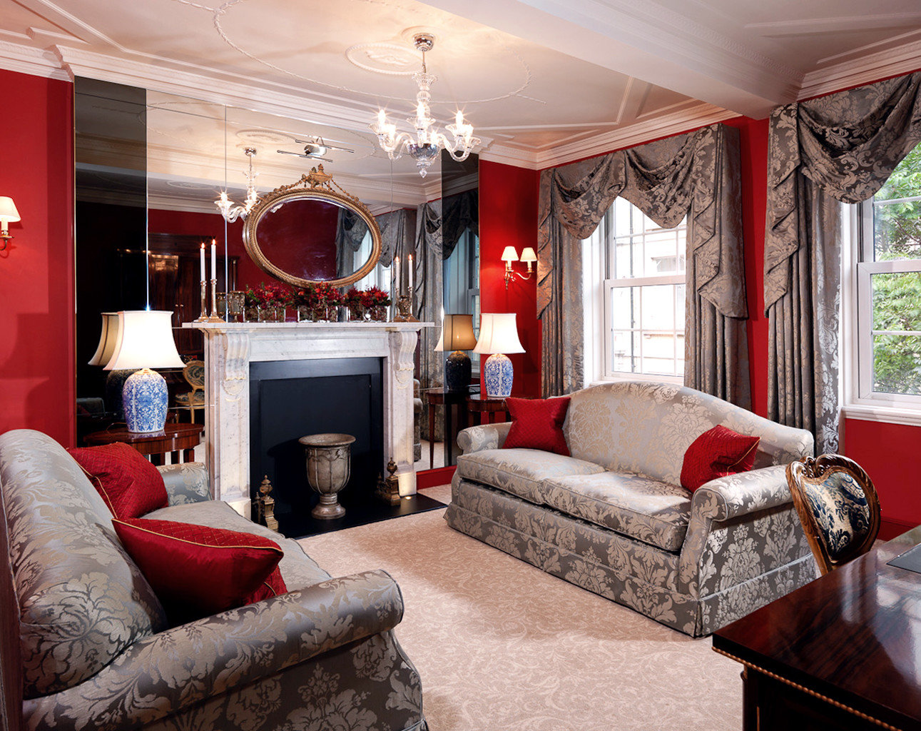 Elegant Hip Hotels Living London Lounge Luxury Luxury Travel sofa room indoor ceiling floor Fireplace furniture living room window property fire home estate interior design real estate decorated cottage Suite area stone flat leather