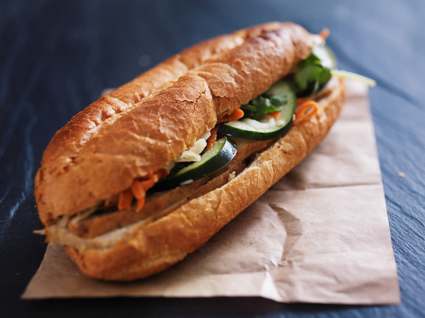 Trip Ideas food paper dish bánh mì snack food sandwich produce veggie burger meat ciabatta baguette close