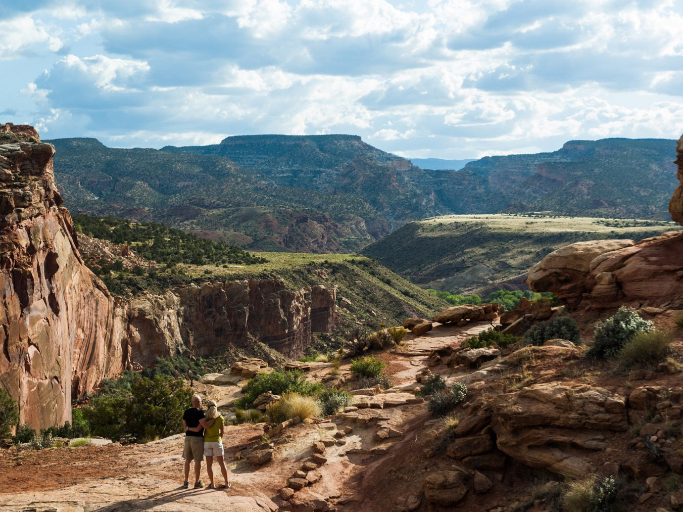 National Parks Outdoors + Adventure Road Trips Trip Ideas mountain outdoor sky valley Nature canyon ground rock geographical feature landform hill rocky badlands wadi tourism geology cliff landscape arch ancient history terrain plateau formation national park park trail hillside dirt