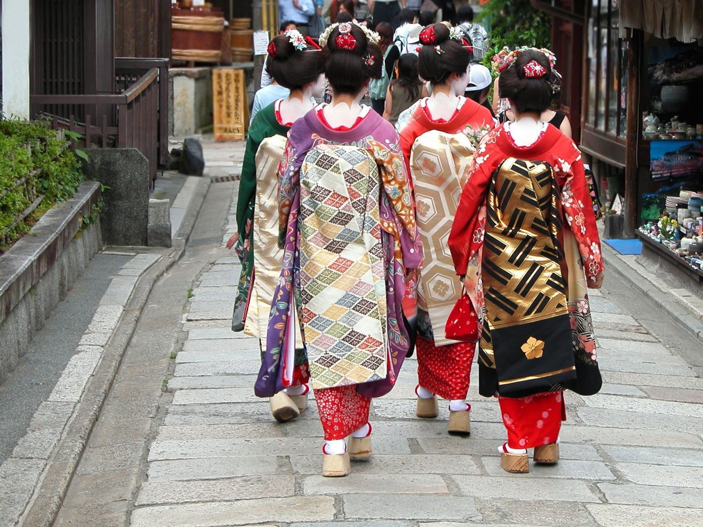 Style + Design outdoor ground person woman clothing sidewalk costume geisha tradition profession temple