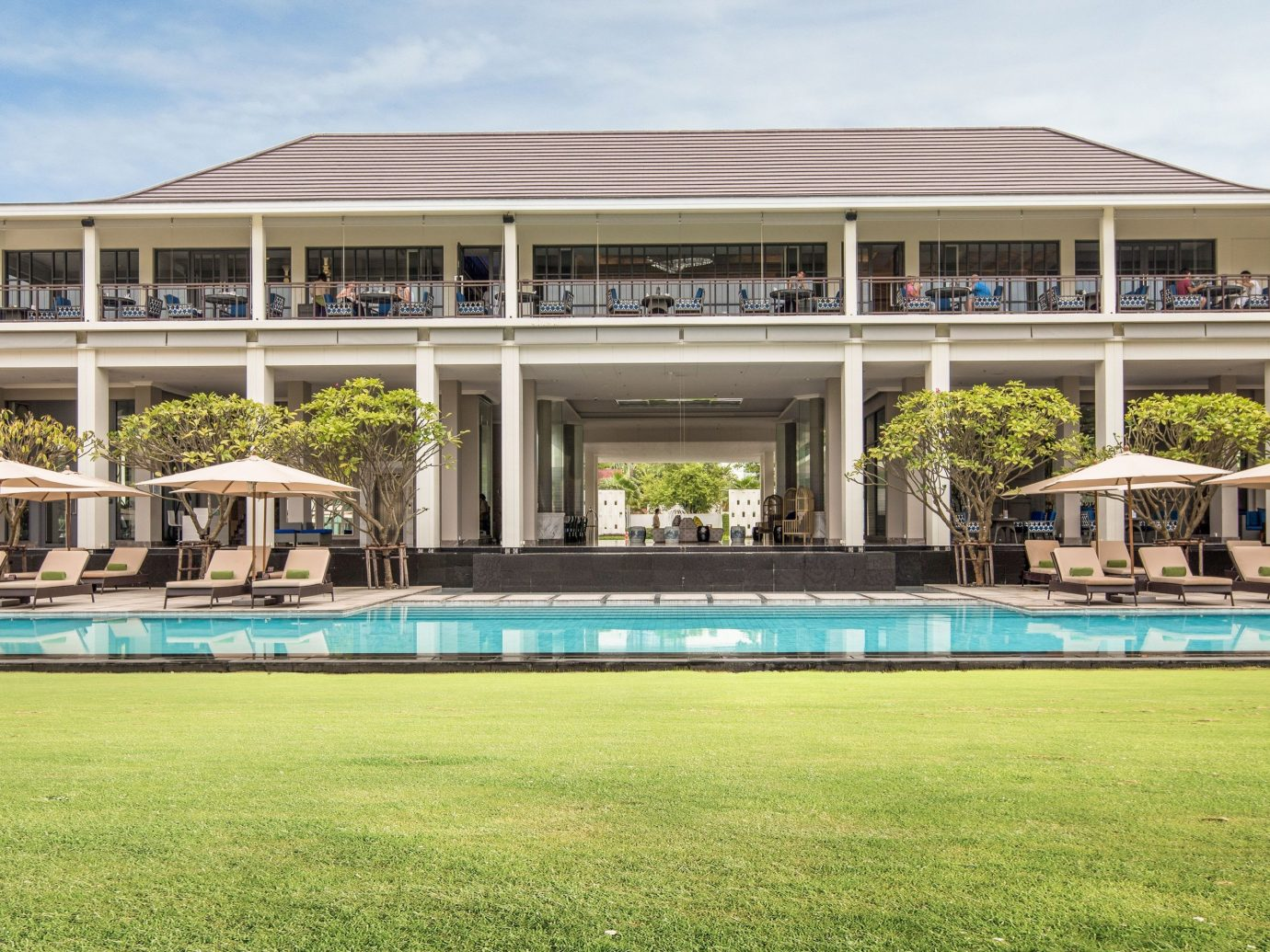 Hotels grass sky outdoor building structure leisure property estate sport venue green leisure centre residential area swimming pool stadium lawn home real estate Resort