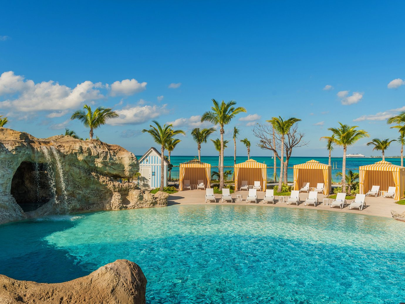 Boutique Hotels Hotels Luxury Travel Resort water swimming pool palm tree arecales leisure sky tree tropics resort town Nature vacation Sea tourism caribbean Lagoon real estate estate Pool water feature bay blue swimming day