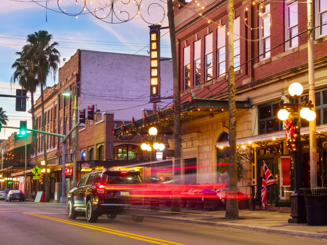 Trip Ideas building outdoor road street Town City neighbourhood urban area human settlement Downtown way night evening infrastructure light cityscape pedestrian plaza sidewalk