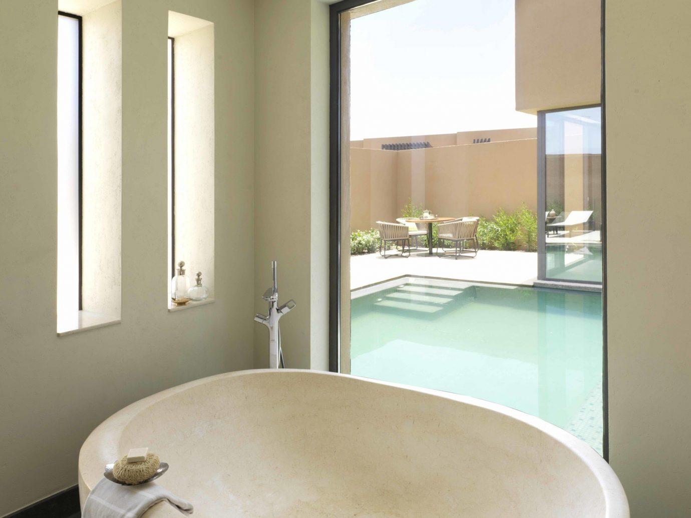 Hotels indoor wall bathroom window floor room bathtub property tub plumbing fixture interior design swimming pool ceiling daylighting bidet flooring Bath
