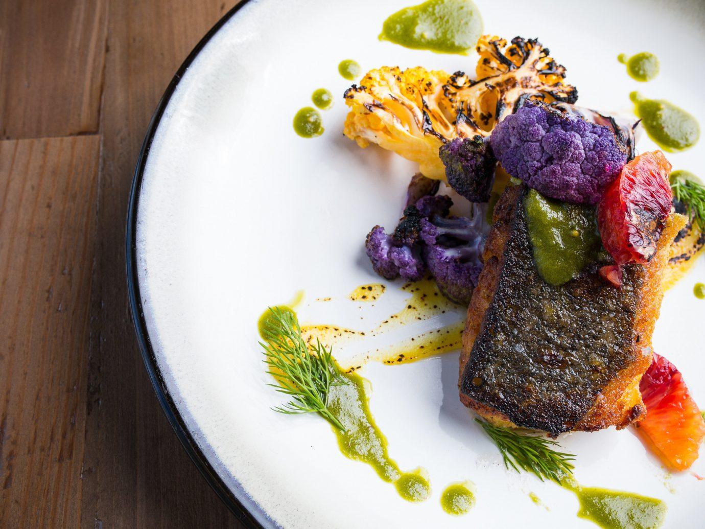 Food + Drink Trip Ideas plate food table dish plant produce meat white fish meal vegetable steak cuisine herb arranged sliced piece de resistance