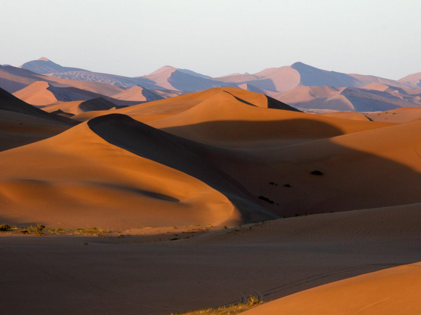 Trip Ideas mountain sky Nature outdoor erg habitat geographical feature natural environment sahara landform Desert aeolian landform landscape orange sand wadi dune plateau distance