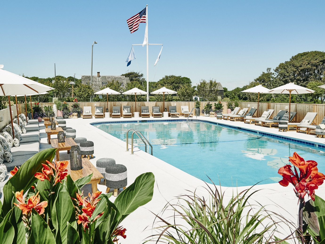 Hotels Style + Design Trip Ideas sky outdoor swimming pool leisure Resort flower plant tourism real estate vacation tree recreation resort town estate water landscape amenity day