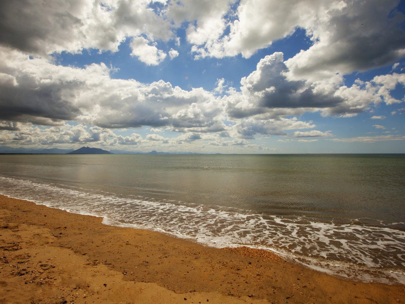 Trip Ideas sky outdoor Beach cloud Sea shore body of water Ocean horizon Coast Nature wave clouds water cloudy wind wave sand sunlight rock meteorological phenomenon bay reflection dusk material sandy day