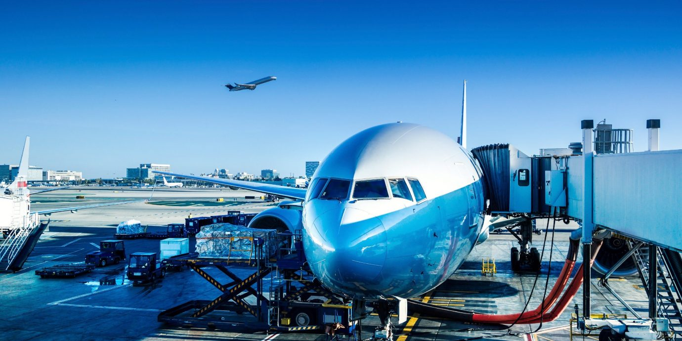 Travel Tips sky plane airplane outdoor airport airline air travel airliner wide body aircraft aviation runway vehicle aircraft atmosphere of earth tarmac jet aerospace engineering blue infrastructure aircraft engine boeing boeing 777 flight docked boeing 747