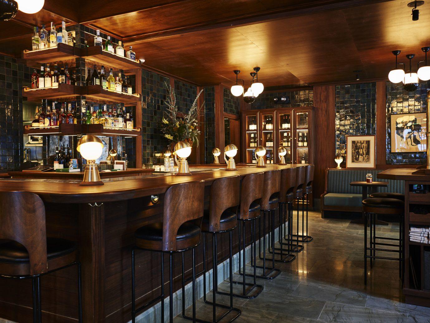 NYC Trip Ideas indoor ceiling table floor Bar room restaurant Dining interior design tavern wooden café pub shelf dining room liquor store furniture wood area set Island several