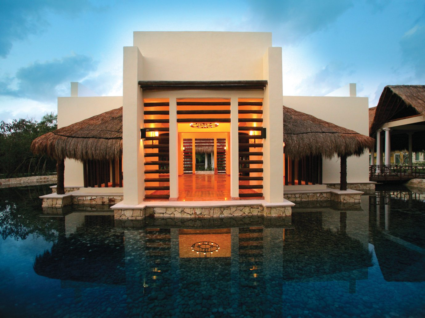 All-Inclusive Resorts Elegant Exterior Hotels Luxury Modern Villa Waterfront sky outdoor water building house property Architecture home estate facade professional swimming pool Resort stone