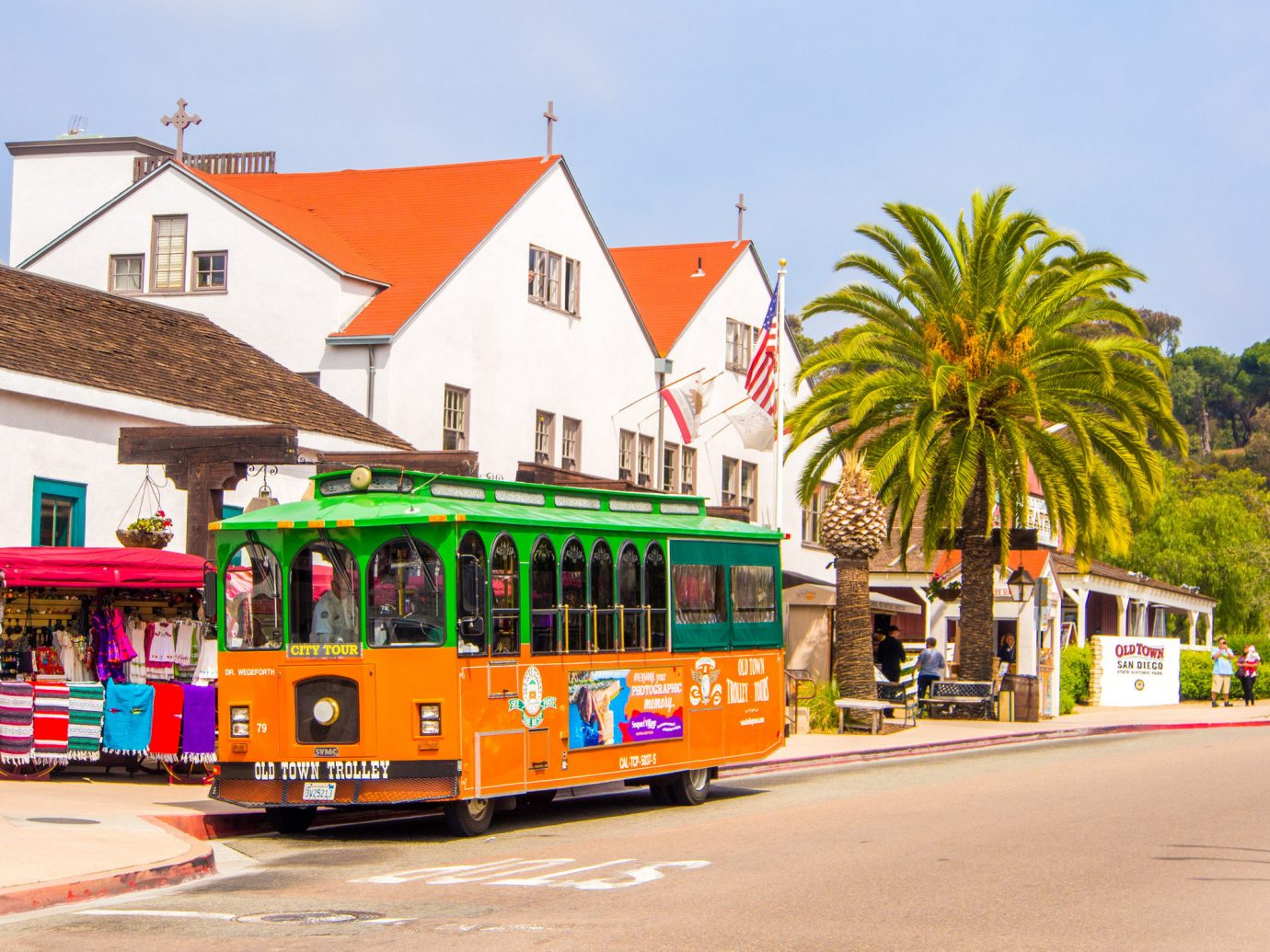 Travel Tips outdoor sky building road transport tram cable car vehicle orange red colorful tree City yellow plant colored