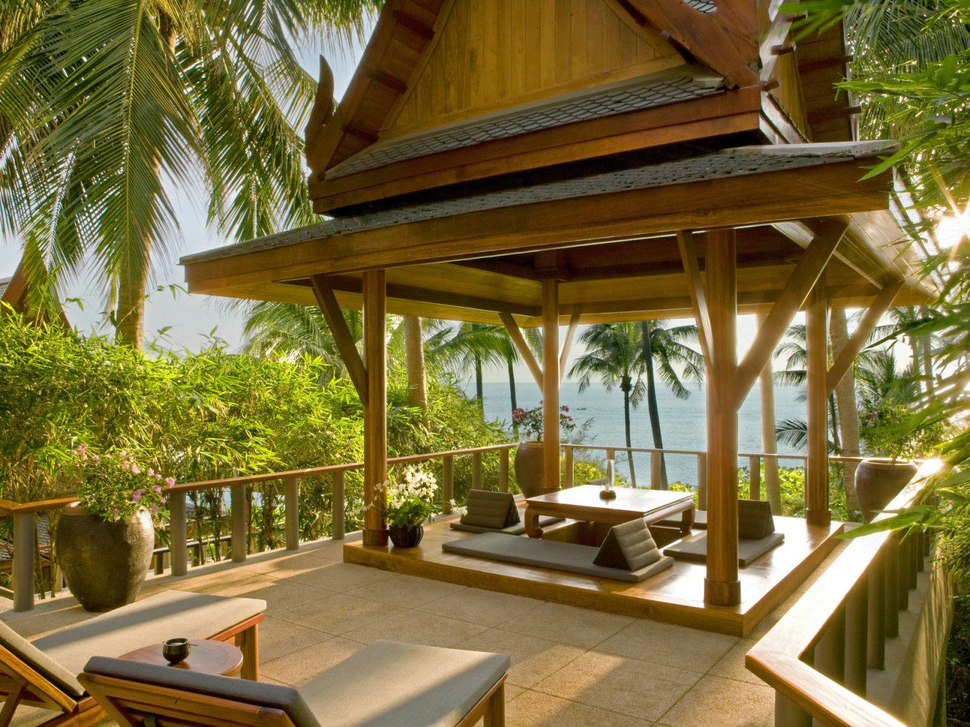 Beach Hotels Phuket Thailand tree outdoor building Resort property estate porch Villa house vacation home outdoor structure eco hotel real estate furniture cottage mansion area Deck shade