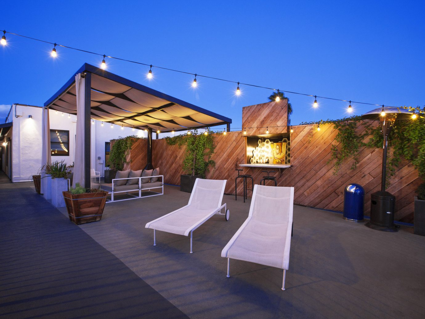Boutique cozy Greenery Hip Hotels Lounge lounge chairs outdoor lounge Outdoors Patio private quaint string lights Terrace trendy sky indoor house Architecture estate lighting restaurant home Resort outdoor structure Villa several
