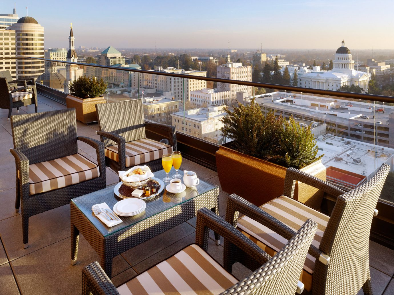 Dining Drink Eat Hip Historic Influencers + Tastemakers Living Lounge Modern Rooftop Scenic views sky table property condominium Balcony outdoor structure real estate estate overlooking