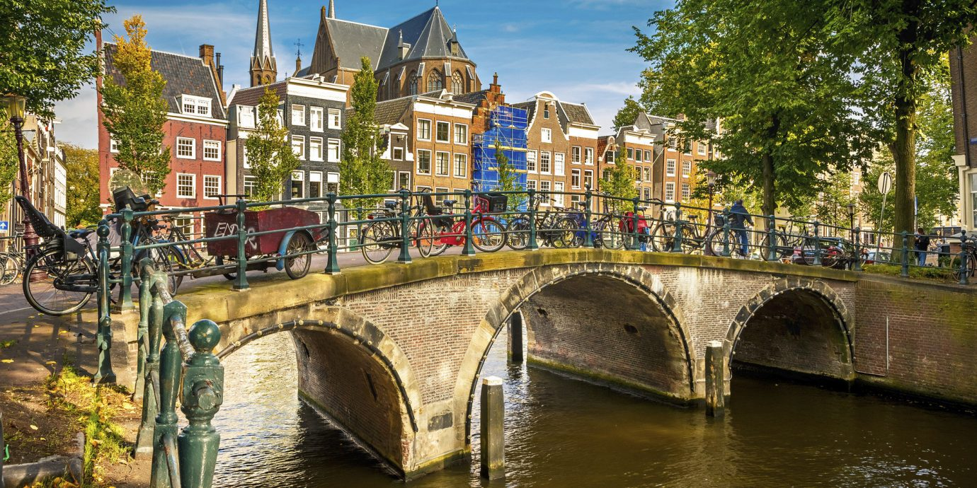 Travel Tips Trip Ideas tree outdoor water Canal River landform geographical feature waterway body of water Town bridge cityscape