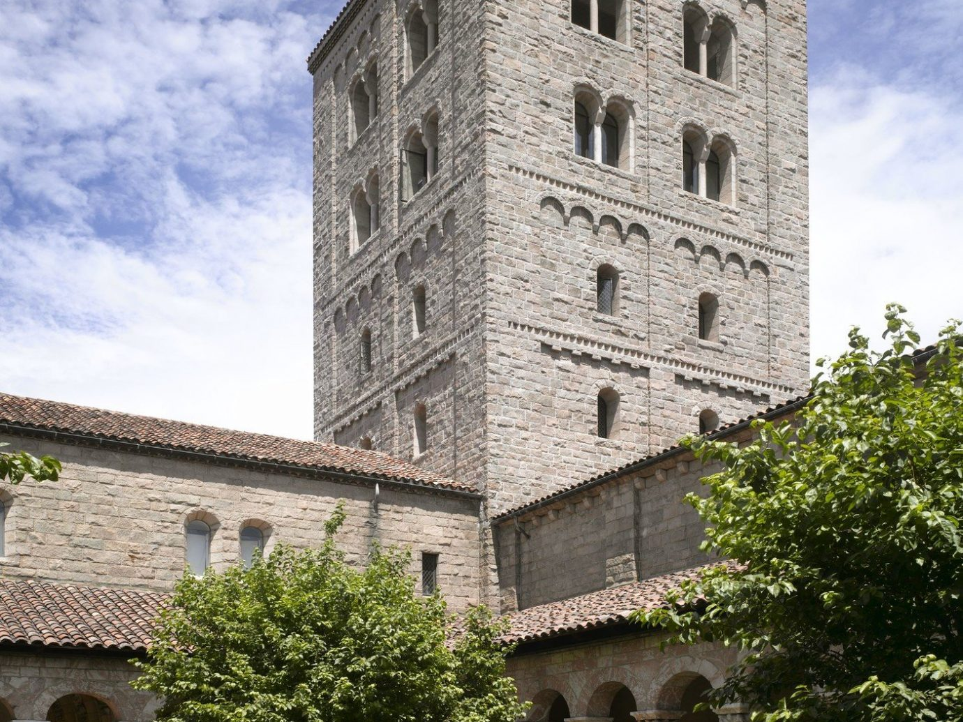 Architecture art Arts + Culture attraction Budget building calm Courtyard culture Exterior Garden Greenery Historic Museums serene tower trees outdoor sky stone landmark brick old place of worship Church bell tower estate ancient history monastery Ruins chapel fortification square