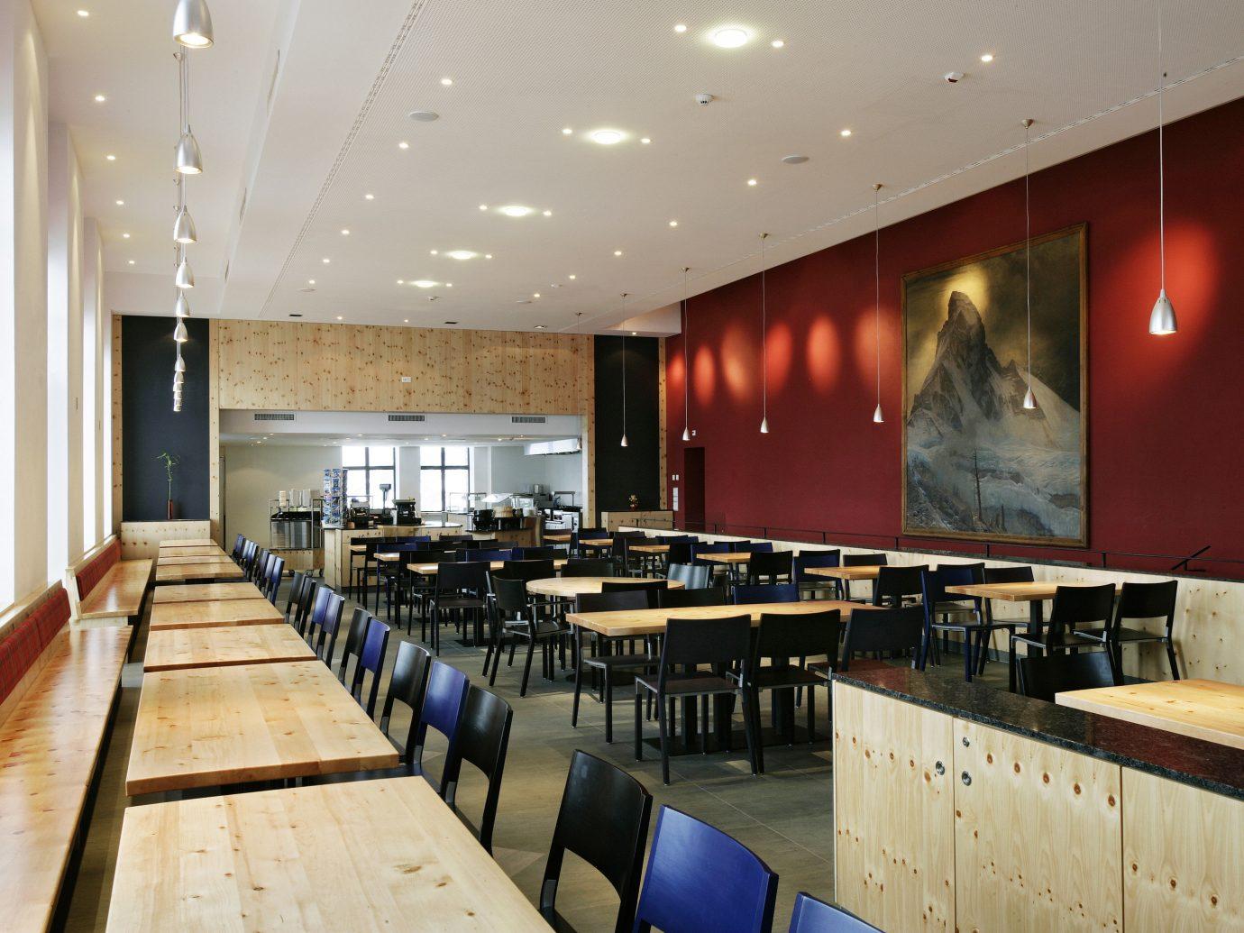 Hotels Offbeat indoor ceiling floor interior design restaurant conference hall table auditorium wood long furniture several dining room