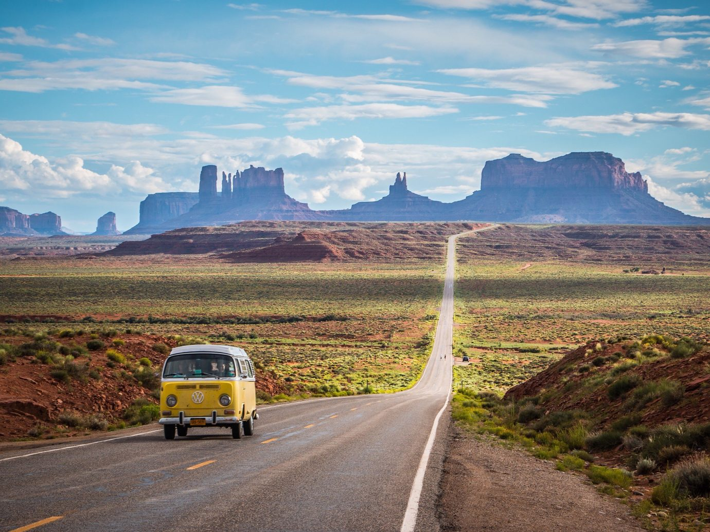 America American Southwest Arts + Culture Brooklyn Canada Hawaii Hotels Los Angeles Morocco New York Oahu Offbeat Road Trips Scotland Toronto Travel Tips Trip Ideas mountain outdoor grass road sky mountainous landforms geographical feature highway horizon road trip landscape morning way valley infrastructure prairie plain mountain range plateau mountain pass dirt